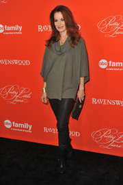Laura Leighton paired a gray cowl-neck blouse with leather skinnies for a casual yet chic look during the 'Pretty Little Liars' screening.