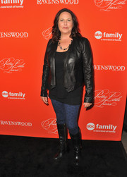 I. Marlene King stepped up the edginess with a pair of black knee-high boots.