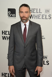 Anson Mount shied away from gaudy shades of red and chose a deep bordeaux-colored tie as he attended AMC's 'Hell on Wheels.'