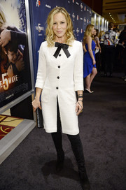 Maria Bello was classic in a white tweed coat adorned with a black bow at the screening of 'The 5th Wave.'