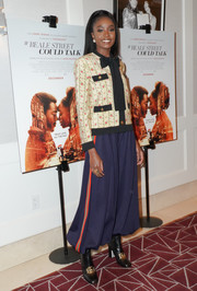 Kiki Layne contrasted her sweet top with funky side-striped harem pants, also by Gucci.