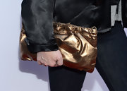 Megan Mullally chose a bronze oversized clutch to accessorize her look at the premiere of 'The Kings of Summer.'