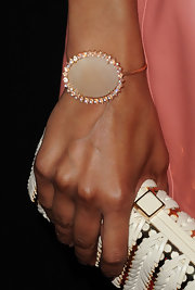 Zoe accessorized her leather mini dress with a statement oval cuff bracelet.
