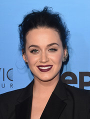 Katy Perry went for an edgy beauty look with dark berry lipstick.
