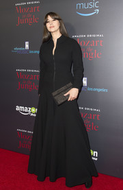 Monica Bellucci went goth in a floor-length black coat dress at the screening of 'Mozart in the Jungle.'