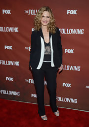 Kyra kept her red carpet look cool and classy with a pair of black slacks.