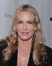 Daryl Hannah sent a message of peace with this diamond peace-sign pendant, which she wore to the screening of 'Greedy Lying Bastards.'