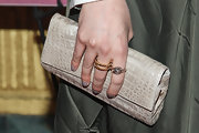 Greta Gerwig attended the 'Frances Ha' screening in LA carrying an elegant taupe crocodile clutch.
