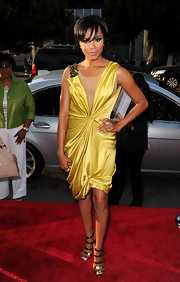 Letoya Luckett paired her strappy sandals with a draped satin dress.