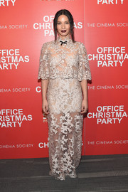 Olivia Munn bared plenty of skin in a sheer nude lace gown by Reem Acra at the screening of 'Office Christmas Party.'