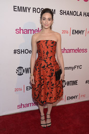 Emmy Rossum paired her pretty dress with strappy black sandals by Sophia Webster.