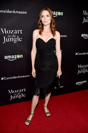 Saffron Burrows was a classic beauty at the 'Mozart in the Jungle' screening in a strapless LBD with a sweetheart neckline and a fringed hem.