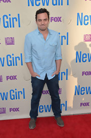 Jake Johnson kept his red carpet look super casual with this blue button down and jeans.