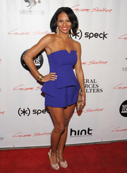 Candace Smith went for a breezy red carpet look with this strapless blue romper during the 'Gimme Shelter' screening in Hollywood.