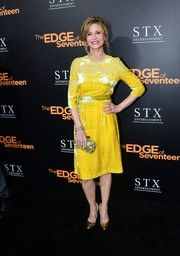 Kyra Sedgwick completed her ensemble with a black and yellow Bottega Veneta Knot clutch.