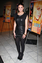 Emmanuelle Chriqui finished off her sleek monochromatic premiere look with black leather platform pumps.