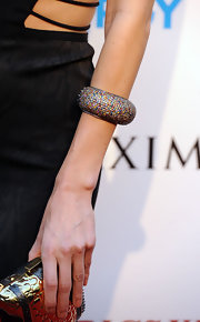 Lake Bell donned her sexy LBD with a vibrant pave multi sapphire cuff bracelet.