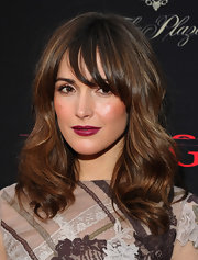 Rose Byrne punched up her pout with a saturated application of cranberry red lipstick. A bronzed cheek and light eye makeup completed her glowing look.