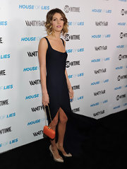 Dawn Olivieri contrasted her black dress with a tangerine box clutch.