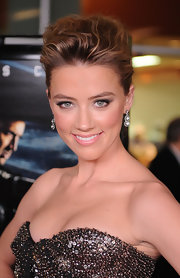 Actress Amber Heard highlighted her textured twisted bun with elegant diamond drop earrings.