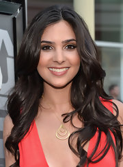 Camila Banus' chocolate tresses tumbled gracefully over her shoulders at the 'Now You See Me' screening in Hollywood.