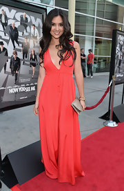 Camil Banus stuck to a flowing maxi dress on the red carpet.