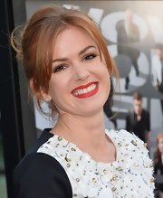 Isla Fisher graced the carpet looking stunning as ever with her fiery locks pulled back into a messy updo.