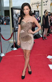 Christian Serratos showed off her fit figure with strapless beaded bandage dress.