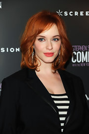Christina Hendricks styled her fiery red locks in soft waves that were parted to the side. She topped off her look with coral lipstick.