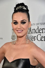 Katy Perry adorned her updo with a silver flower pin.