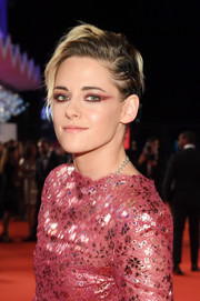 Kristen Stewart amped up the edge factor with heavy winged eyeshadow.