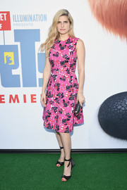 Lake Bell oozed feminine appeal in a fuchsia floral dress by Oscar de la Renta during the New York premiere of 'The Secret Life of Pets.'