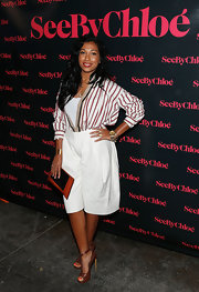 A striped cardigan added a preppy touch to Melanie Fiona's look.