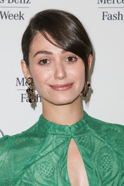 Emmy Rossum opted for a simple side-parted bun when she attended the Monique Lhuillier fashion show.