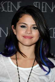 Selena Gomez wore her long layered tresses with vibrant blue and violet streaks at a UNICEF benefit in West Hollywood.