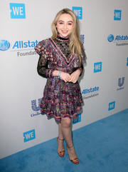 Sabrina Carpenter got all frilled up in an Anna Sui floral mini dress with a lace neckline and sleeves for WE Day California.