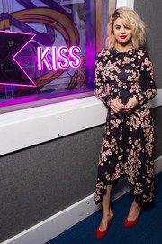 Selena Gomez kept it ladylike in a handkerchief-hem floral dress by Isabel Marant while visiting KISS FM.