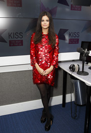 Selena Gomez dazzled in a paillette-embellished red plaid dress by Preen while visiting Kiss FM.