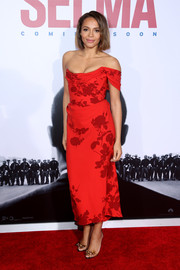 Carmen Ejogo teamed her dress with a sweet pair of bowed PVC sandals by Christian Louboutin.