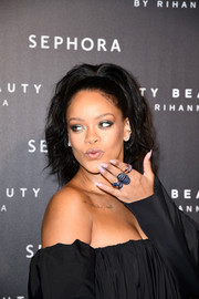 Rihanna attended the Fenty Beauty launch in Paris wearing an Etho Maria pink sapphire and amethyst ring.