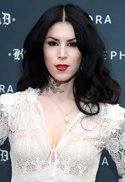 Kat Von D punched up her look with a splash of bold red lip color.