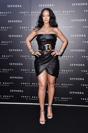 Rihanna looked fierce in a strapless LBD by Versace at the Sephora Loves Fenty Beauty launch.