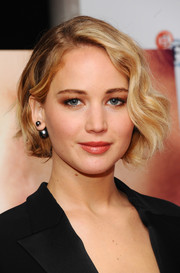 Jennifer Lawrence polished off her look with on-trend Dior tribal earrings.
