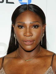 Serena Williams sported a center-parted, flat-ironed hairstyle at the premiere of her documentary.