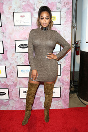 La La Anthony oozed sex appeal even without showing much skin in this figure-hugging ribbed sweater dress from the Serena Williams Signature Statement collection.