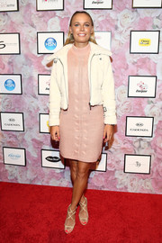 Caroline Wozniacki showed her support for BFF Serena Williams by attending her Signature Statement fashion show clad in a pink cable-knit sweater dress from the label.