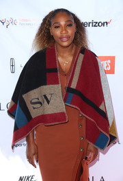Serena Williams kept warm with a personalized shawl by Burberry while celebrating her Yetunde Price Resource Center's partnership with Apartment List.