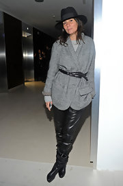 Emmanuelle Alt teamed her edgy pants with an oversized gray tweed jacket.