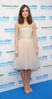 Keira Knightley recycled her Chanel Couture wedding dress, featuring sheer sleeves and a tulle skirt, for the SeriousFun London Gala. It isn't hard to see why--she looks ethereal in it!