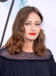 Ella Purnell went for an eye-popping beauty look with some bright red lipstick.